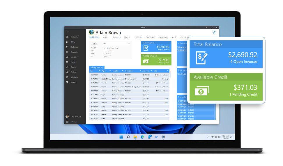 Laptop displaying billing dashboard in Wise Software - Enterprise.